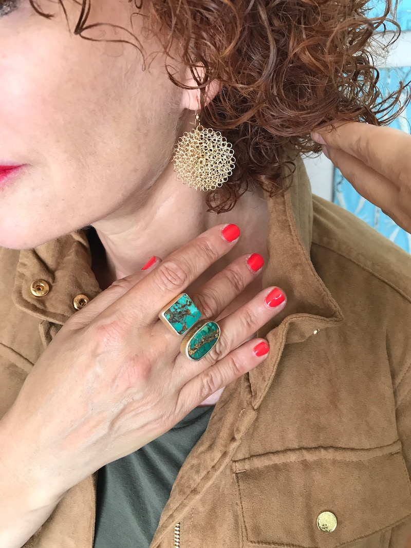 gold woven drop earrings, gold and green stone ring