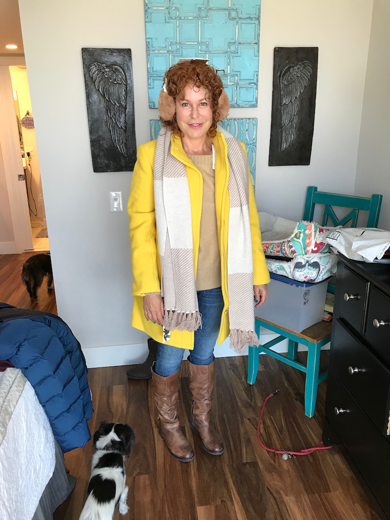 vince tan sweater, talbots yellow coat, rag & bone light blue jeans, rag & bone light blue denim, tan ear muffs, beige and cream fringe edge scarf, raffini brown leather knee high boots