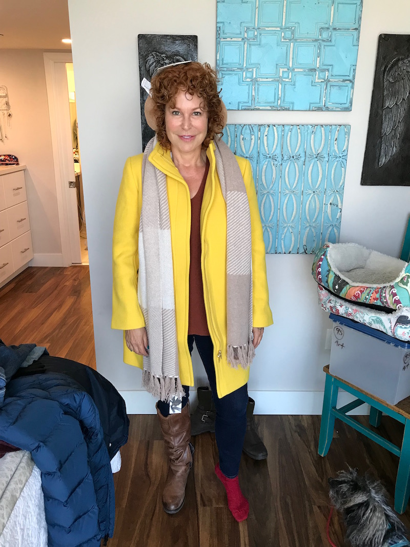 talbots yellow coat, gap dark blue jeans, gap dark blue denim, tan ear muffs, beige and cream fringe edge scarf, raffini brown leather knee high boots