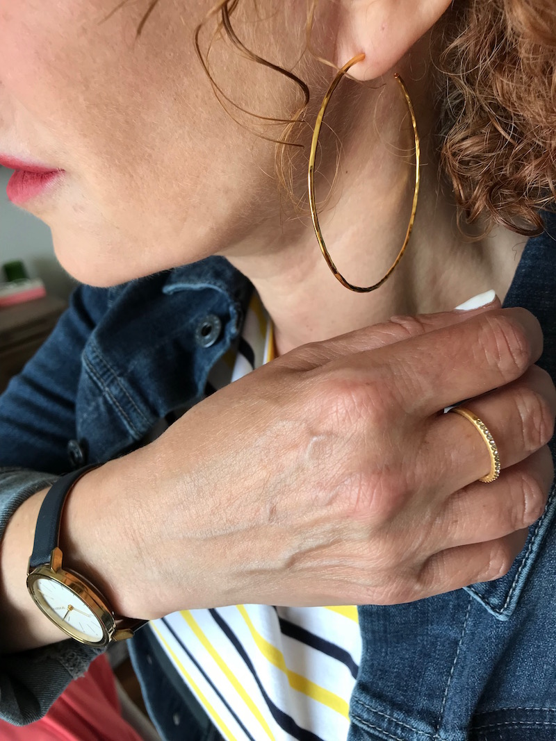 gold hoop earrings, gold and crystal ring, navy blue and gold watch