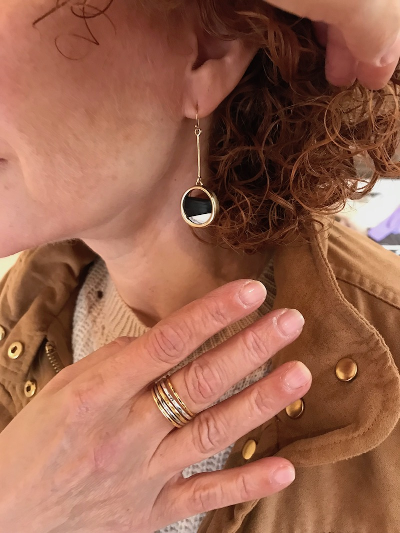 gold and black circle cut out drop earrings, mixed gold ring