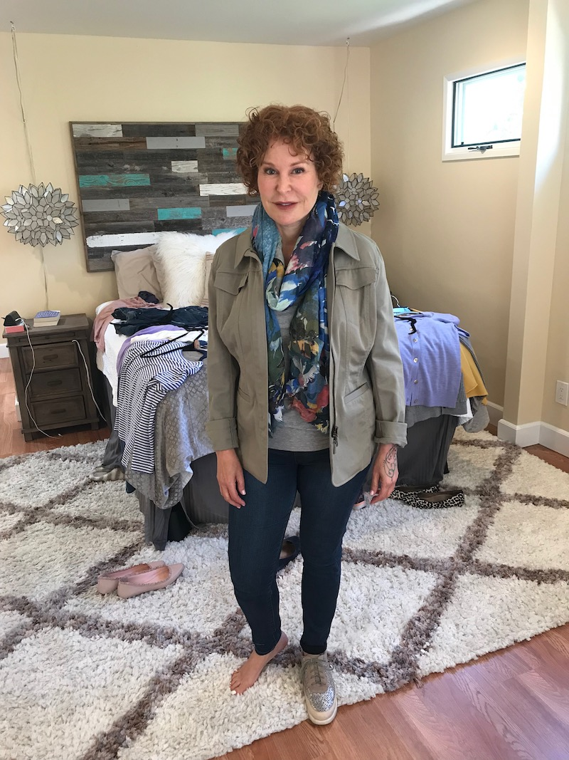 light grey tee, army green jacket, multi-color print scarf, dark blue skinny jeans, l'amour des pieds blush and silver sneakers