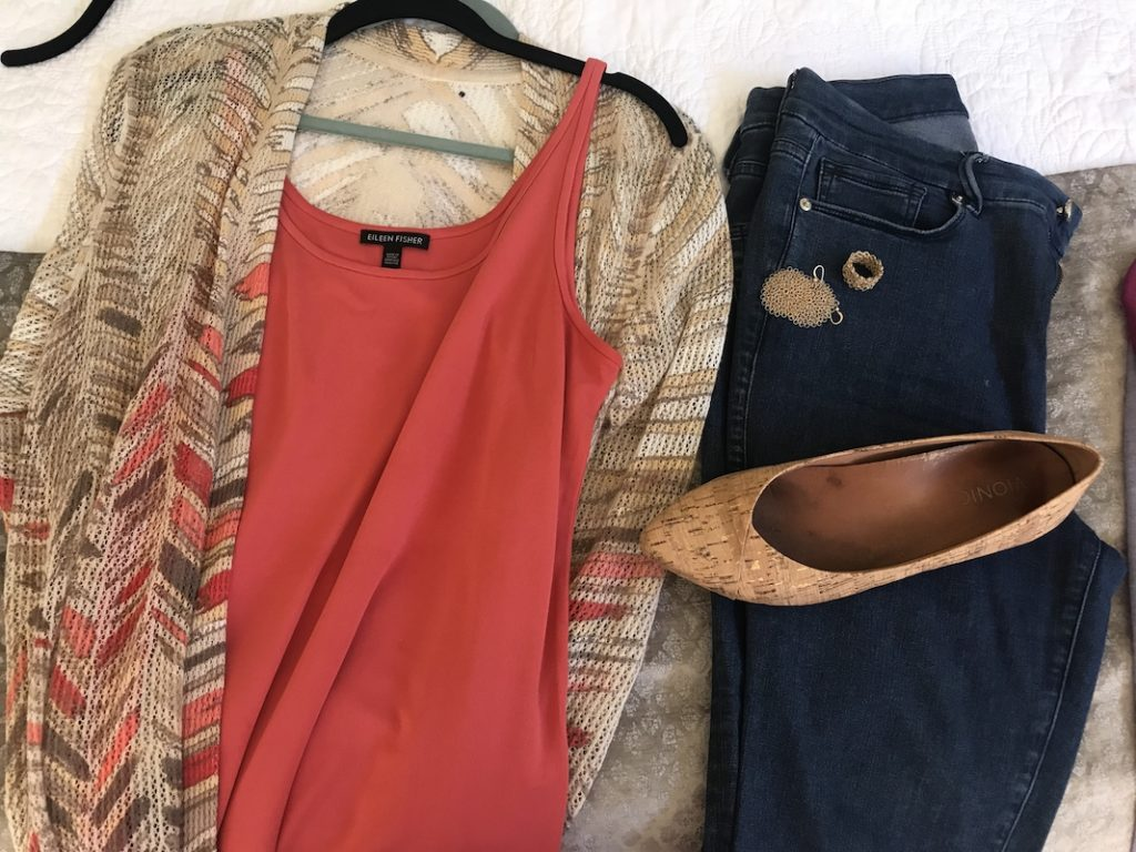 Eileen Fisher coral tank top, Good American dark blue jeans, Vionic Cork flats, gold disc earrings, gold ring, multicolored cardigan