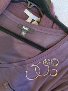 Paige purple t-shirt, gold rings, gold hoops