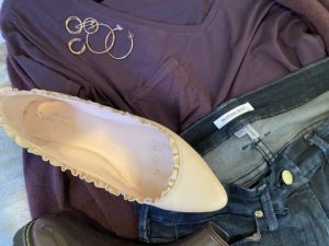 Good American blue jeans, Kate Spate pink ruffle flats, gold rings, gold hoops