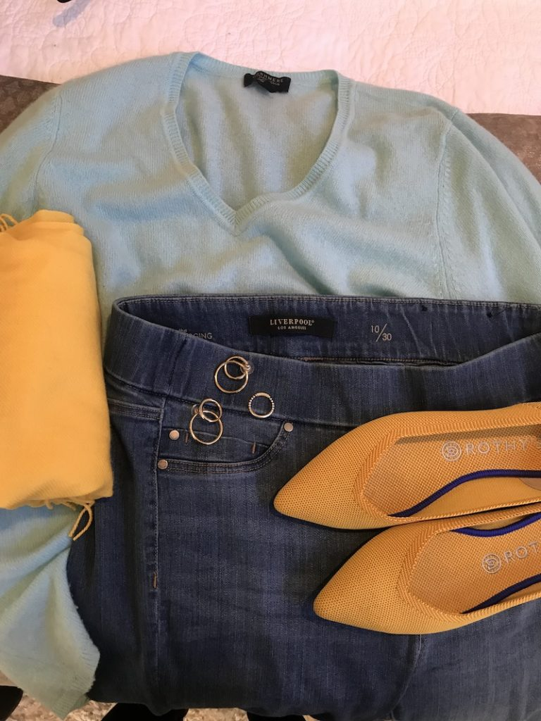 Light blue cashmere sweater, Liverpool medium blue jeggings, yellow Rothys, yellow scarf, gold double hoop earrings, gold ring