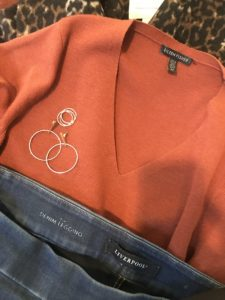 Eileen Fisher orange v neck swaater, gold hoop drop earrings, gold rings