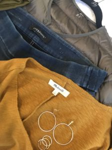 Madewell yellow long sleeve shirt, gold hoop drop earrings, gold rings, Liverpool medium blue jeggings, Uniqlo gray puffer jacket