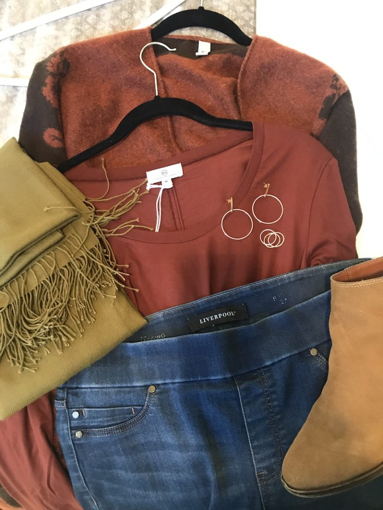 AG burgundy long sleeve shirt, Liverpool medium blue jeggings, tan scarf, Lucky Brand tan boots, Accessory Street burgundy and brown floral cardigan