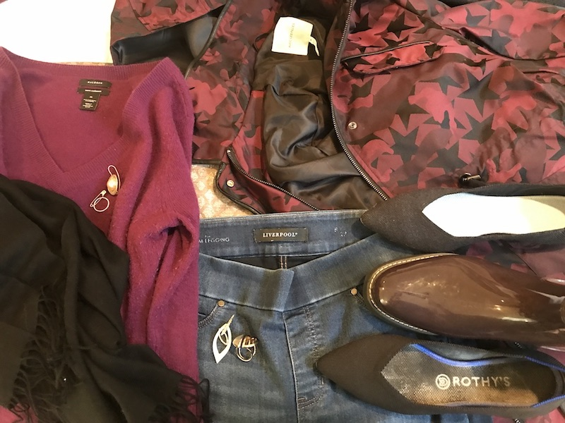 Halogen dark red V neck sweater, Liverpool medium blue jeans, black scarf, black Rothys, Shadow Rothys, Cougar dark red rain boots, Avec Les Filles red and black star jacket, gold rings, gold drop earrings, gold statement ring