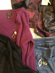 Halogen Burgundy V-neck sweater, Liverpool medium blue jeans, black scarf, gold rings, gold drop earrings, gold statement ring, Avec Les Filles black and red star coat