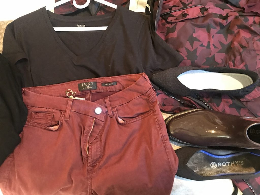 Madewell black long sleeve V neck t shirt, Jen7 dark red jeans, Avec Les Filles black and red star jacket, black Rothys, dark grey Rothys, Cougar dark red rain boots, gold rings, gold hoops