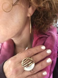 gold drop earrings, gold and white statement ring