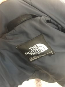 The North Face navy blue puffer coat