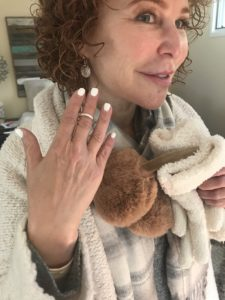 brown earmuffs, silver ring, silver disc earrings