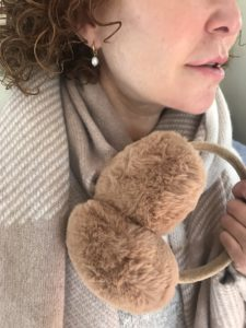 brown earmuffs, pearl earrings